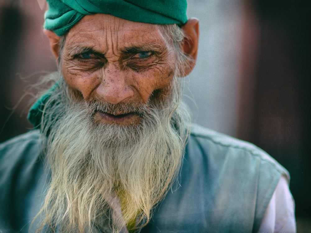 A man walks outside of a Mosque in Old Delhi, India. Canon 5D Mark III, Sigma 85mm, 1/2500 sec, f/1.8