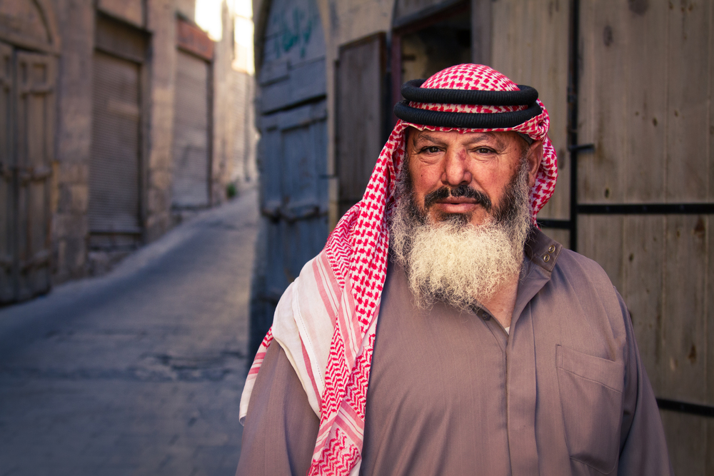 A merchant outside of a narrow ally way in Al-Salt, Jordan. Canon 7D, Canon 28-300mm , 1/400 sec, f/5