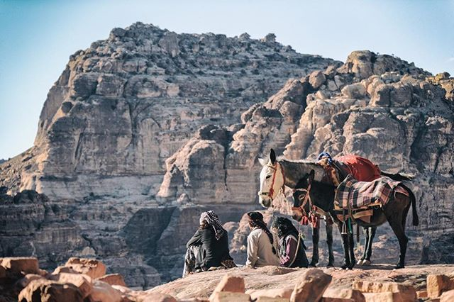 Three men take a late afternoon break on the hills above Petra, Jordan. @thegivinglens @resourcetravel @visitjordan #ResourceTravel #ShareYourJordan #VisitJordan #Petra #Travel #Travel #OpenMyWorld #intrepidtravel #BBCTravel #LonelyPlanet #Jordan