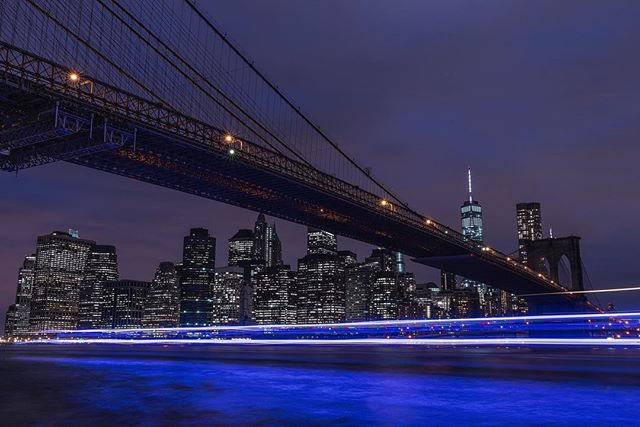 "6am was way to early to be on an airplane in San Francisco, but at least I'm heading to New York City for the @nytimestravel Travel Show. Who is in town? I took this long exposure of the Brooklyn Bridge as a police boat came by to check on me. He said I looked ""Shady"". I take that as a compliment. #ResourceTravel"
