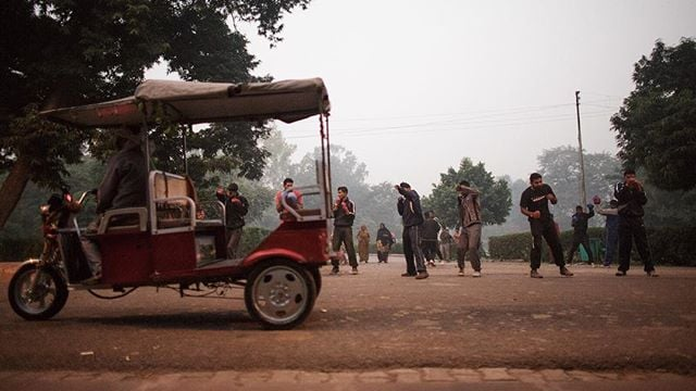 Members of the Indian Army shadow box in the early morning hours as a tuk tuk passes by on the streets of Agra, India. #ResourceTravel #Travel #India #LonelyPlanet #TravelGram #Boxing #Agra #Asia #PassionPassport #DoYouTravel #OpenMyWorld #IntrepidTravel #TheGivingLens #TGLIndia #LonelyPlanetIndia