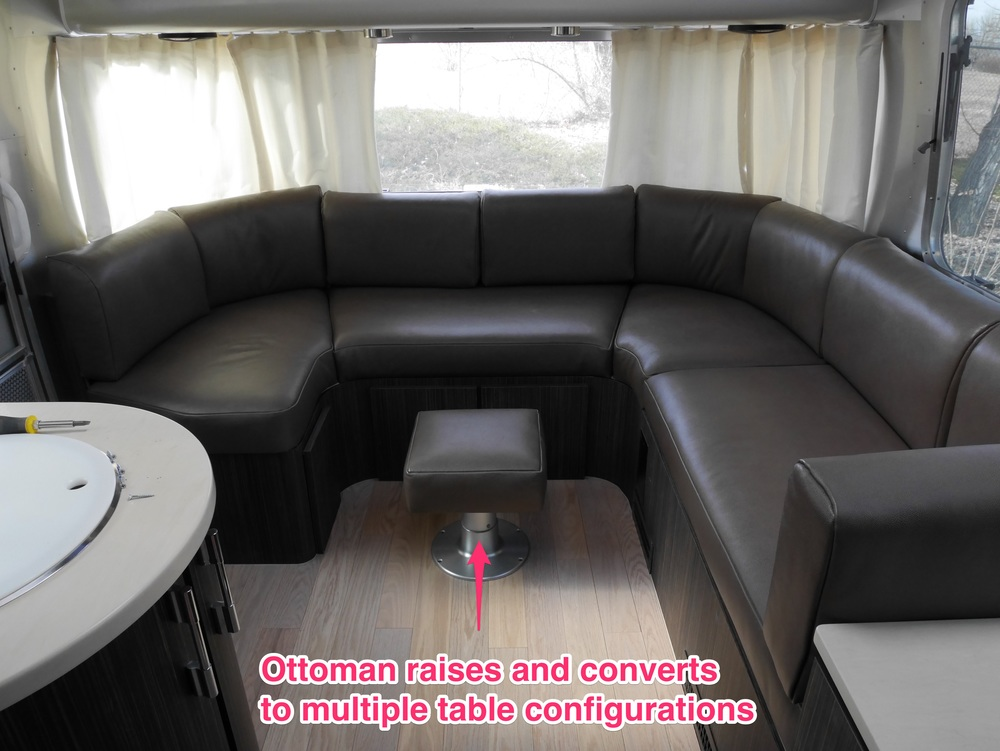 The lounge area has been replaced, losing the gaucho but gaining some much-needed comfort and efficiency improvements. The table (stored under the seat on the right) can convert into a large desk space or a normal sized kitchen table (more photos coming when we get the Airstream back from AM Solar later this week)..