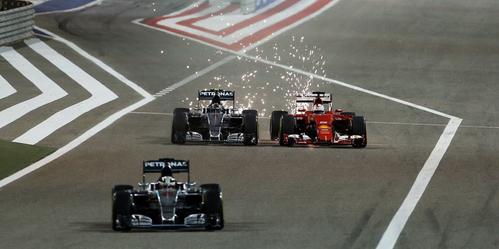Rosberg overtakes Vettel into Turn 1 as Lewis Hamilton leaves the pits. Sparks!