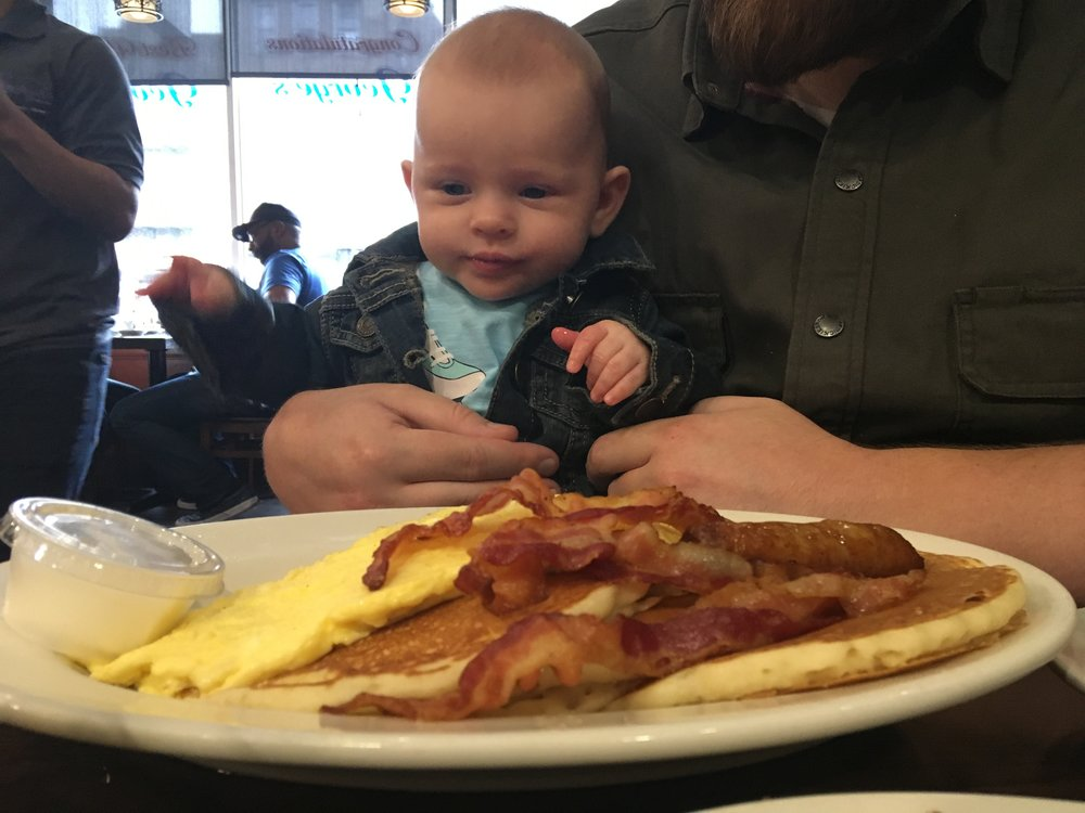 My daughter Ava, at 4 months -  almost,  but not quite, ready to dive into daddy's breakfast at the local diner.