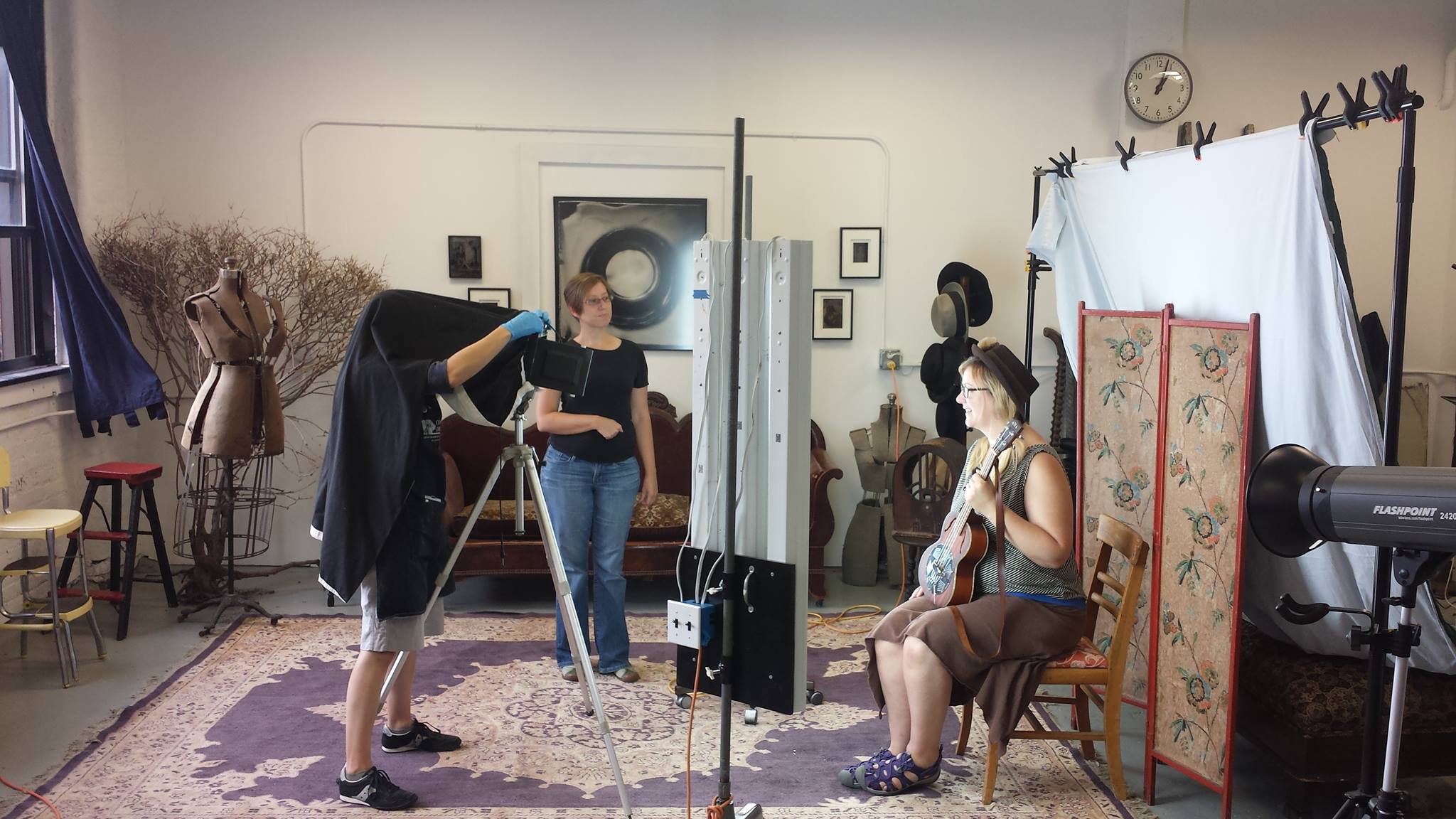 Jenn Libby making a tintype portrait in her studio, Genesee Libby Photography.