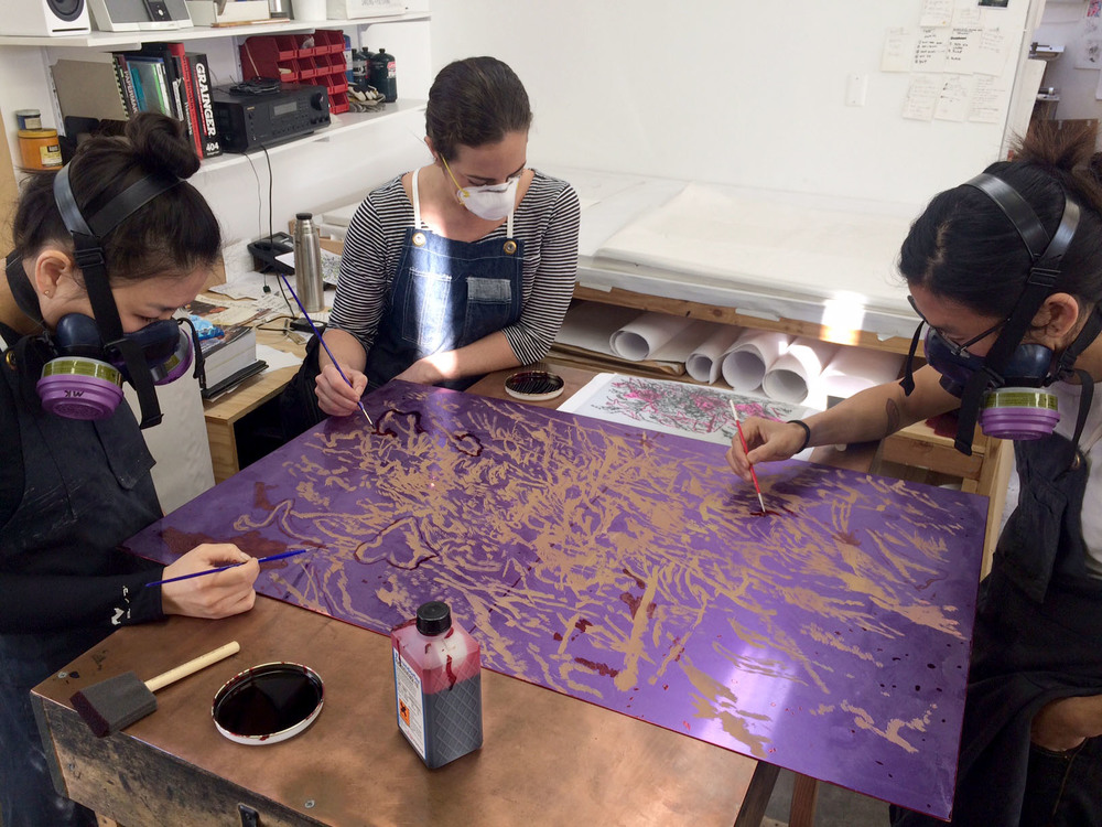 Myungwon, Amy and Kenny blocking out areas with lacquer before etching. I helped lead this team in proofing and editioning.