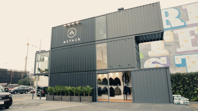 thisistheverge :      Watch this: Aether builds a sleek San Francisco boutique from three shipping containers    Aether is a predominantly web-based retailer, but the California-based outerwear company has recently begun expanding its brick-and-mortar business, with the launch of a new and innovative shop in San Francisco. Constructed from three, vertically stacked shipping containers, the shop has a distinctly industrial design that, as co-founders Palmer West and Jonah Smith explained to Cool Hunting, dovetails perfectly with Aether's urban-rugged aesthetic.