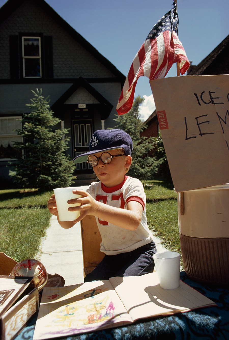 natgeofound :     A boy sells lemonade from his front yard stand on Main Street in Aspen, Colorado, 1973. Photograph by Dick Durrance II, National Geographic Creative