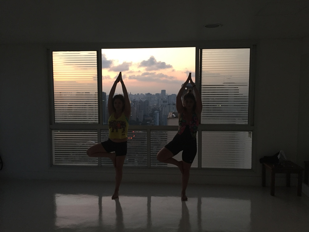 Night 1 in Sao Paulo. I taught Daniella and Marina a barre/yoga class in a studio overlooking the entire city. Here they are in tree pose.