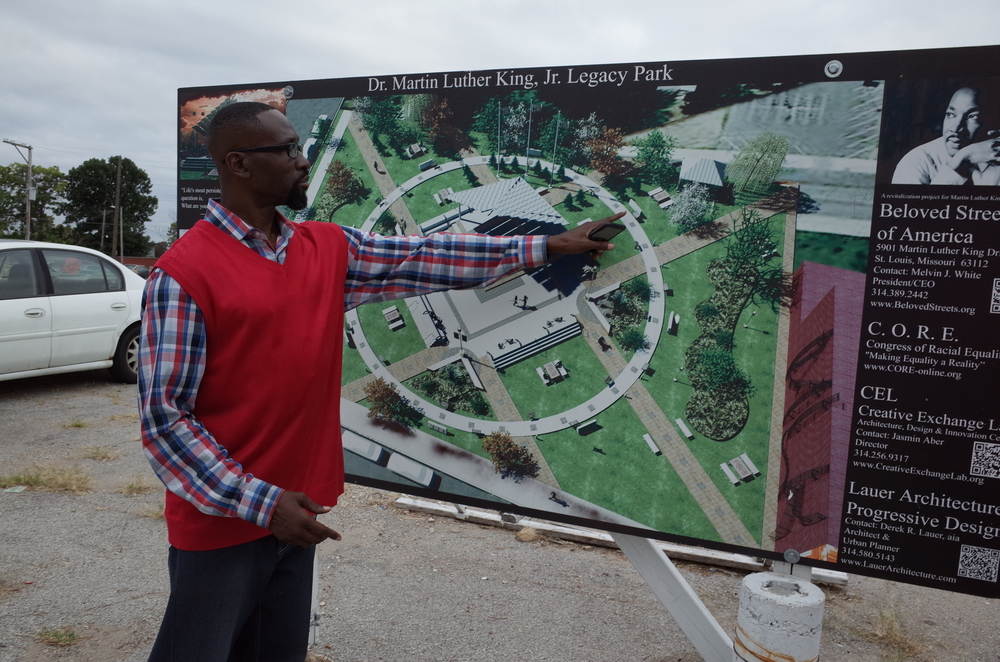 figure 3: Melvin White showing his plans for the vacant lot across the street from his office. Photo Credit: Elena Chang