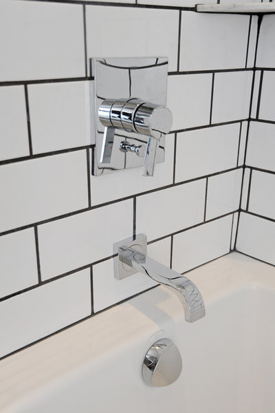 A&E Construction White Subway Tile Black Grout.jpg