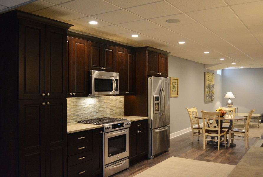 Basement Kitchen Dark Wood Stainless Steel Appliances Recess Lighting  Optimized