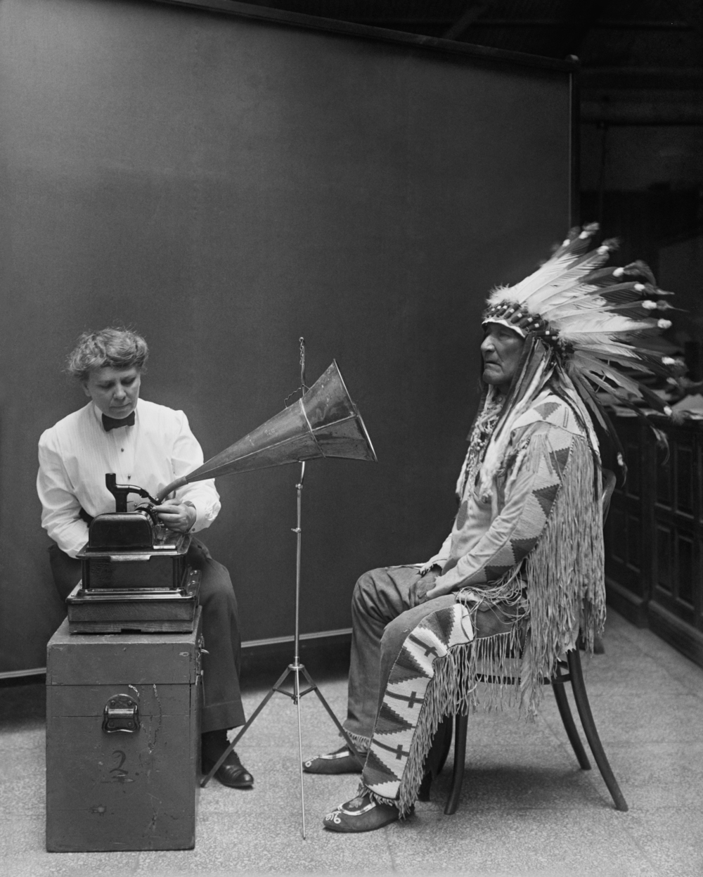 Frances Densmore with Blackfoot chief, Mountain Chief, during a 1916 phonograph recording session for the Bureau of American Ethnology.