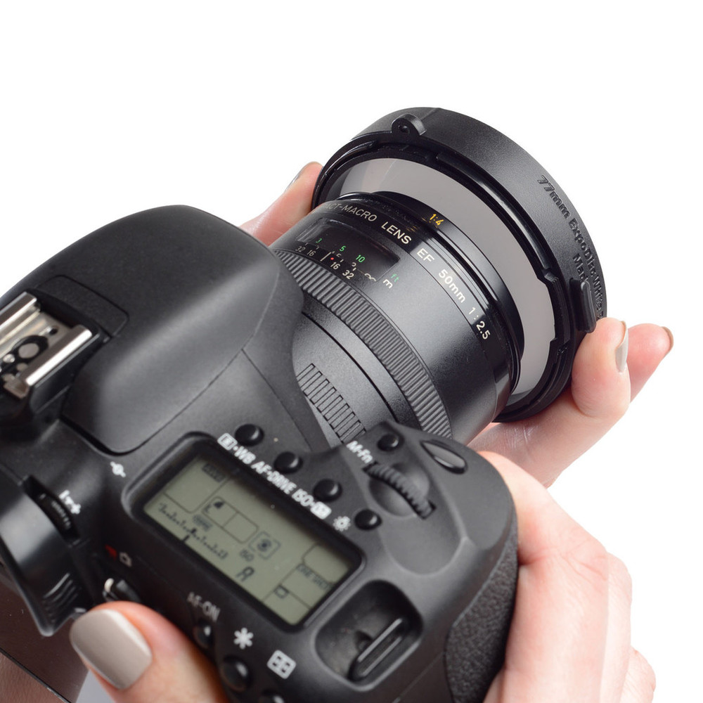 Buy the Expodisc for your largest lens. Place it snugly over your lens to create a custom white balance.