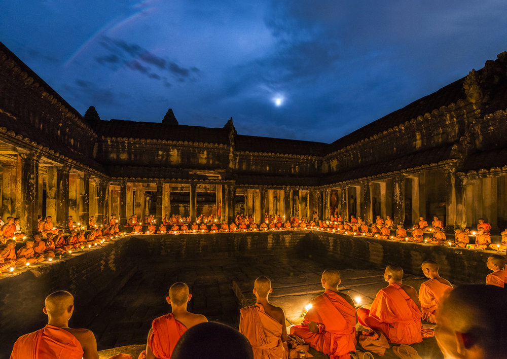 Monks meditating under the light of the full moon.