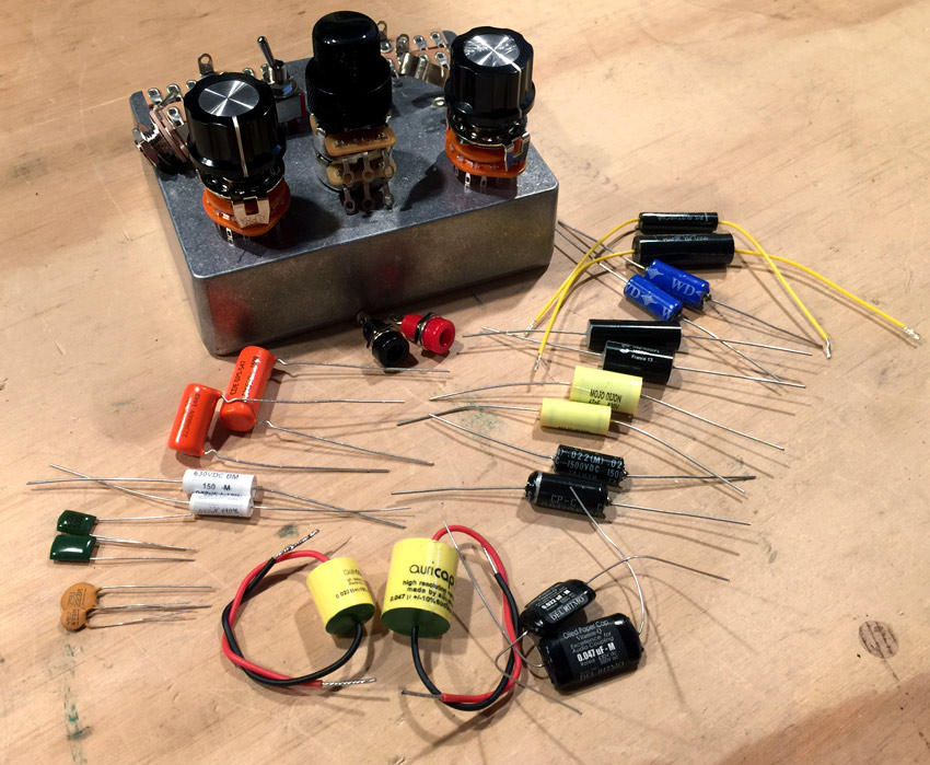 Eleven different brands of capacitors will fit inside the box.  I'll be able to compare really common ceramic and mylar capacitors to other more expensive capacitors like Orange Drop, Mallory 150, Mojo Dijon, Oil-in-paper, Vitamin Q and a few others.