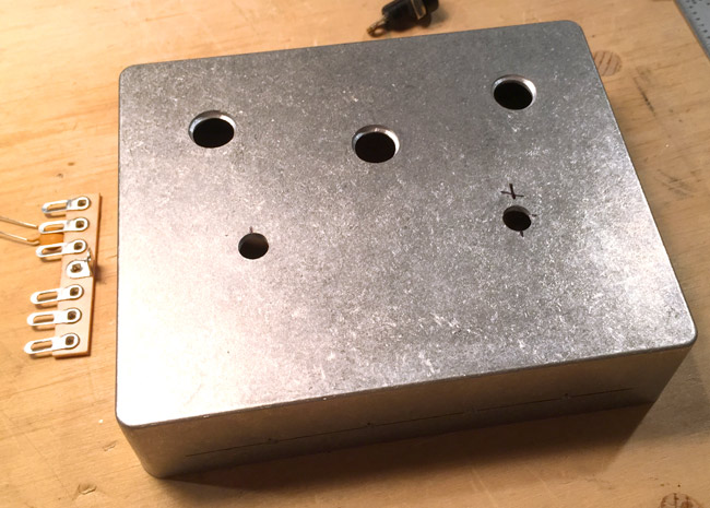 "For smaller holes I simply chose the correct size bit and used a stepper bit for the larger 3/8"" diameter holes."