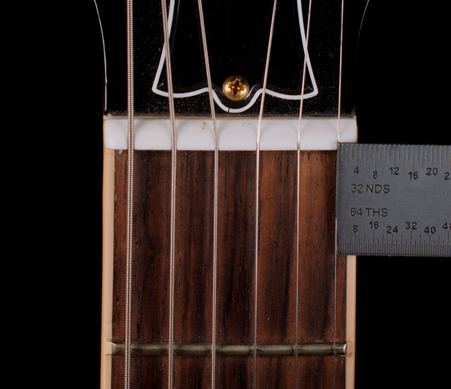"The high e string should be the same distance from the edge of the board as the low E but direct from the factory ""Custom Shop"" they got it wrong.  A small detail that affects the playability of any guitar."