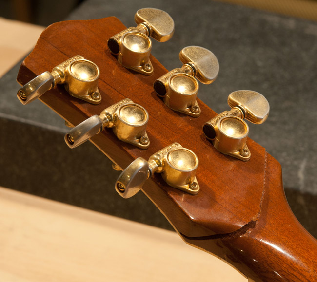 Even a guitar falling off a guitar stand can suffer a broken headstock.   Here is a vintage Gretsch Silver Jet with a broken headstock only being held on by the plastic headstock veneer.