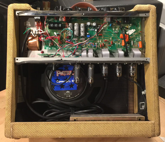 "Fender Blues Juniors prior to 2001 had a green circuit board.  Test markings on this amps circuit board show May of 1995 which is when the ""Rev-B"" design first appeared."