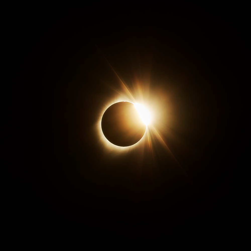 "The ""diamond ring"" just after totality.  1/100s * f/8 * ISO 100 * 200mm"