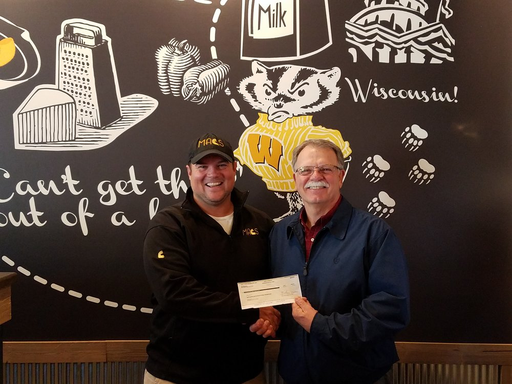 MACS – Macaroni and Cheese Shop in Wisconsin Dells and Lake Delton is committed to supporting the Wisconsin Dells Education Foundation and graduates of Wisconsin Dells High School.  Owner Nick Morse presents a $550 donation check to WDEF Administrator, Bob Johnson.  The WDEF is grateful for this generous donation and thanks everyone who contributed to the MACS Benefit Day for the WDEF on September 27.