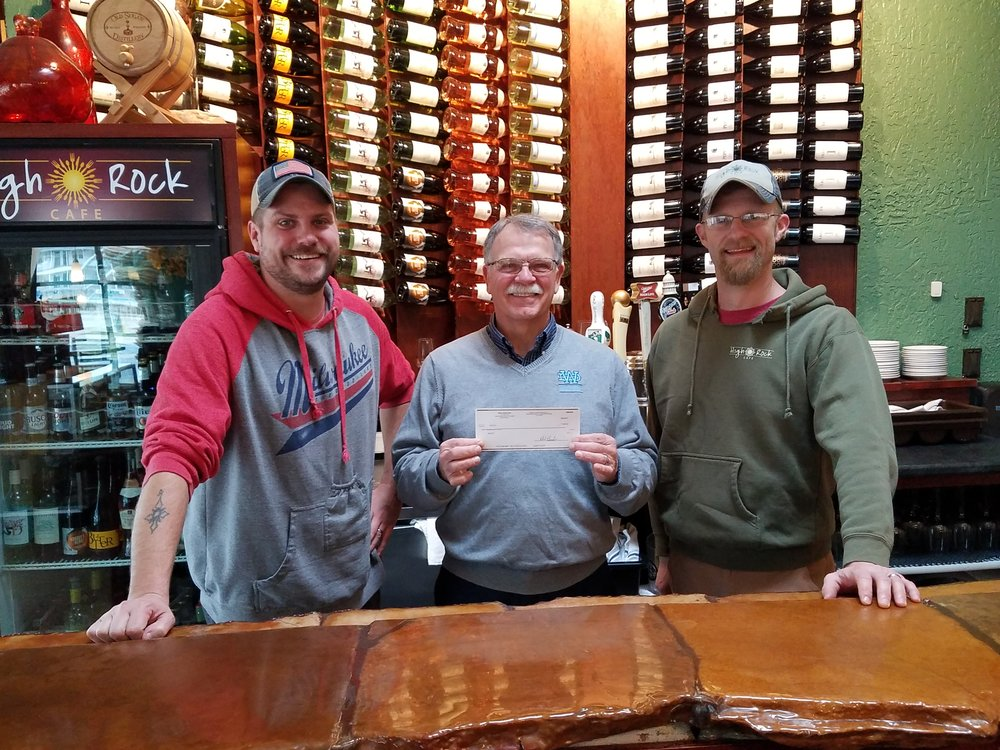 Justin Draper and Wade Bernander, co-owners of High Rock Café in Wisconsin Dells and graduates of Wisconsin Dells High School, present Bob Johnson, Administrator for the Wisconsin Dells Education Foundation, with a check for $1,000.00. This donation was the result of a benefit held for the WDEF on Wednesday, October 10, at High Rock Café and will be used to endow the High Rock Café Culinary Department Finalist Scholarship. The Wisconsin Dells Education Foundation would like to thank Justin and Wade, their staff and community members who attended High Rock Café to make this donation possible.