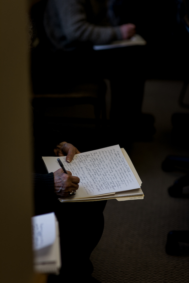 Community member writing a memory as led by the artists through the exercise. Photo credit Megan Lee Photography