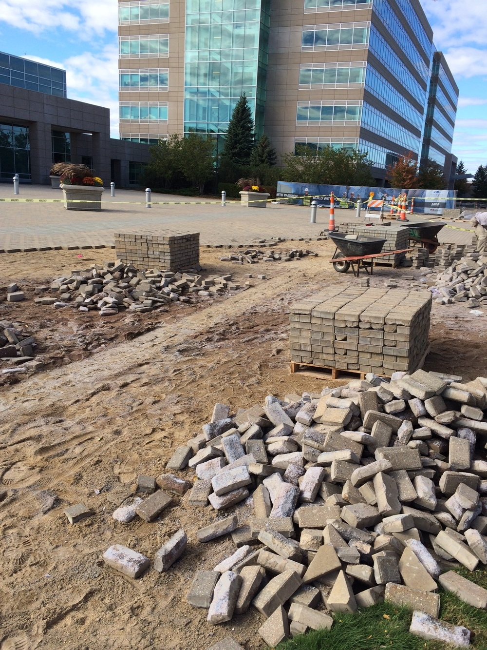 Removal of pavers from plaza for new drive lane