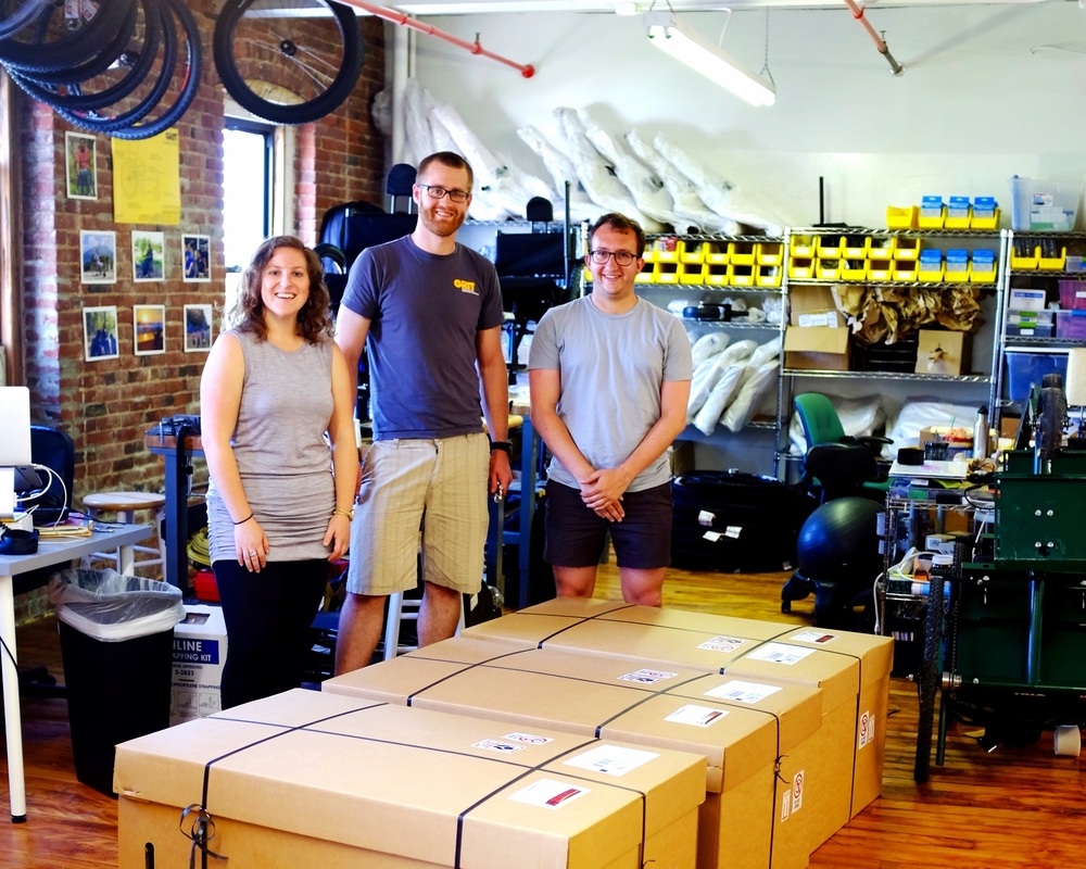 We paused for a photo to commemorate our first shipment, and then we promise we got right back to assembling the next batch!