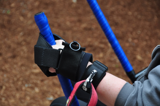 Utilizing the  Liberty Wristband  in conjunction with the  Active Hands grip aids  on the levers of the  GRIT Freedom Chair.