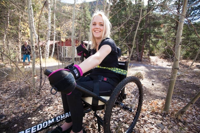 Although she has a high level spinal cord injury, Ellie uses a combination of  Active Hands Grip Aids  and a chest strap to allow her to operate the  GRIT Freedom Chair  safely and independently.