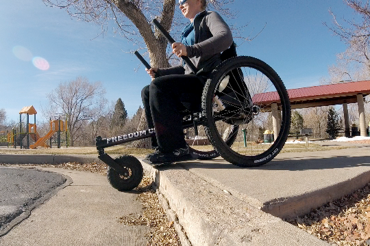 One thing that I truly love about the Freedom Chair is that I can just ride straight off of a curb.