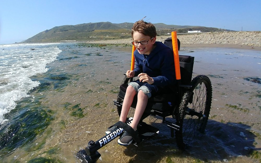 "Why did Ollie choose the Freedom Chair? For ""independent mobility in parks, backyards, at the beach… really anywhere he wanted to go."""