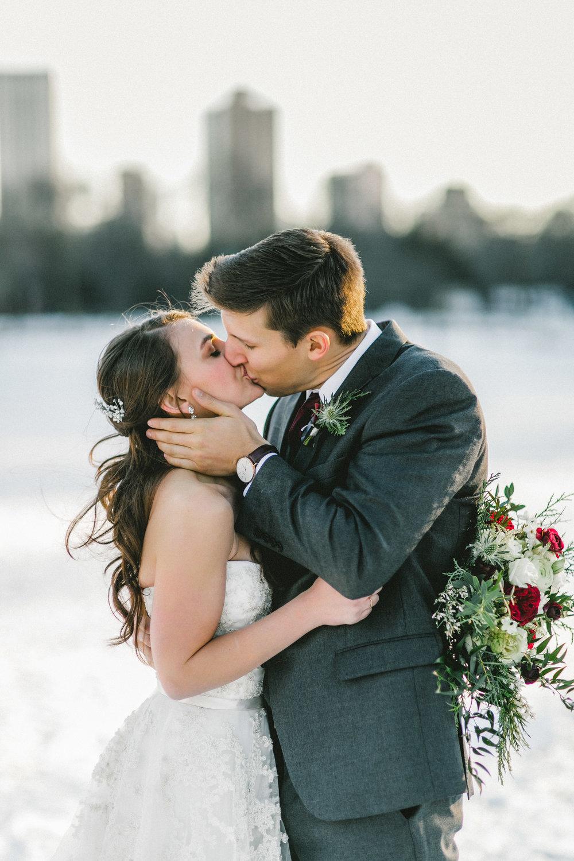 Winter Snowy Wedding Couple Kissing Portrait