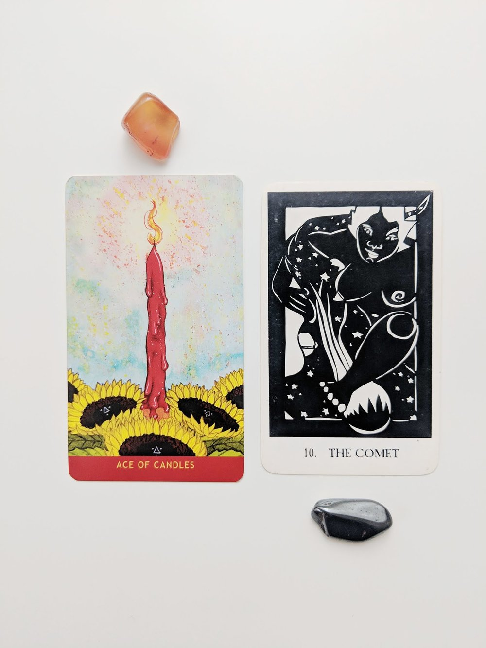 The Numinous Tarot  by Noel Arthur Heimpel (left) and  Thea's Tarot  by Rhea West