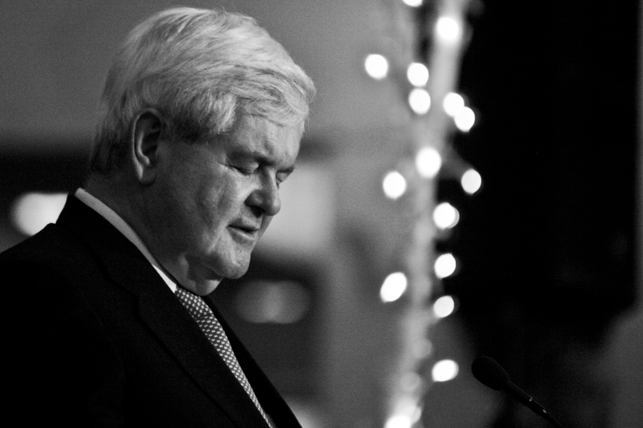 Newt:    (Ben Corda/The News-Star)   I recently had the chance to photograph two GOP presidential candidates. I wanted to shoot primes like old school photogs… I also shot some film in a really old camera that takes a lot of guess work, just to see if I would be able to catch something interesting. I still have to develop (in a dark room) the film I shot but here is a shot of Newt Gingrich. Not a normal shot, but I liked it all the same.