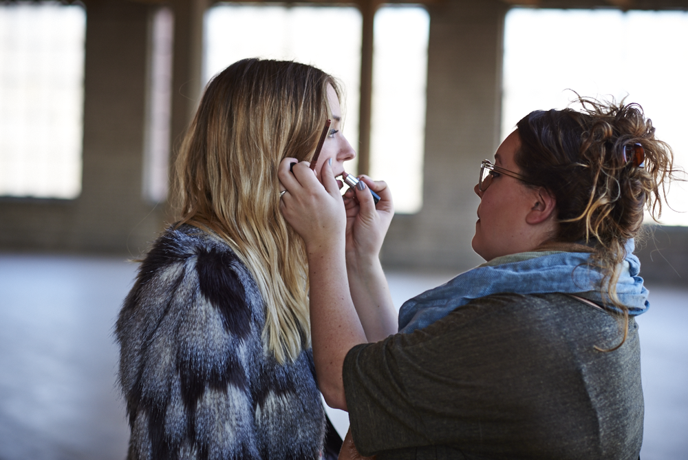 MUA, Emily Gremel putting some finishing touches to lip color.