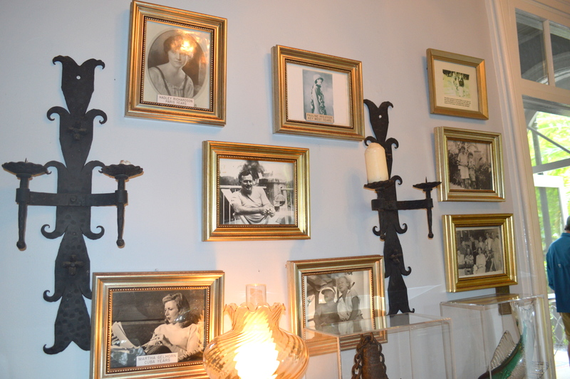 """The """"Hemingway's Wives"""" wall in the dining room. That's not actually the name for it but that is basically what it is! Pictures of all 4 wives!"""