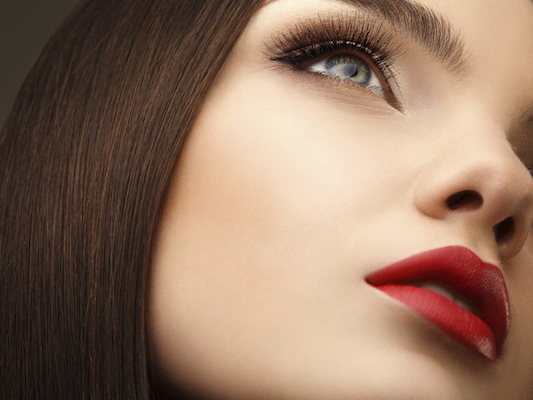 Woman Eye With Beautiful Makeup and Long Eyelashes. Red Lips. High quality image.