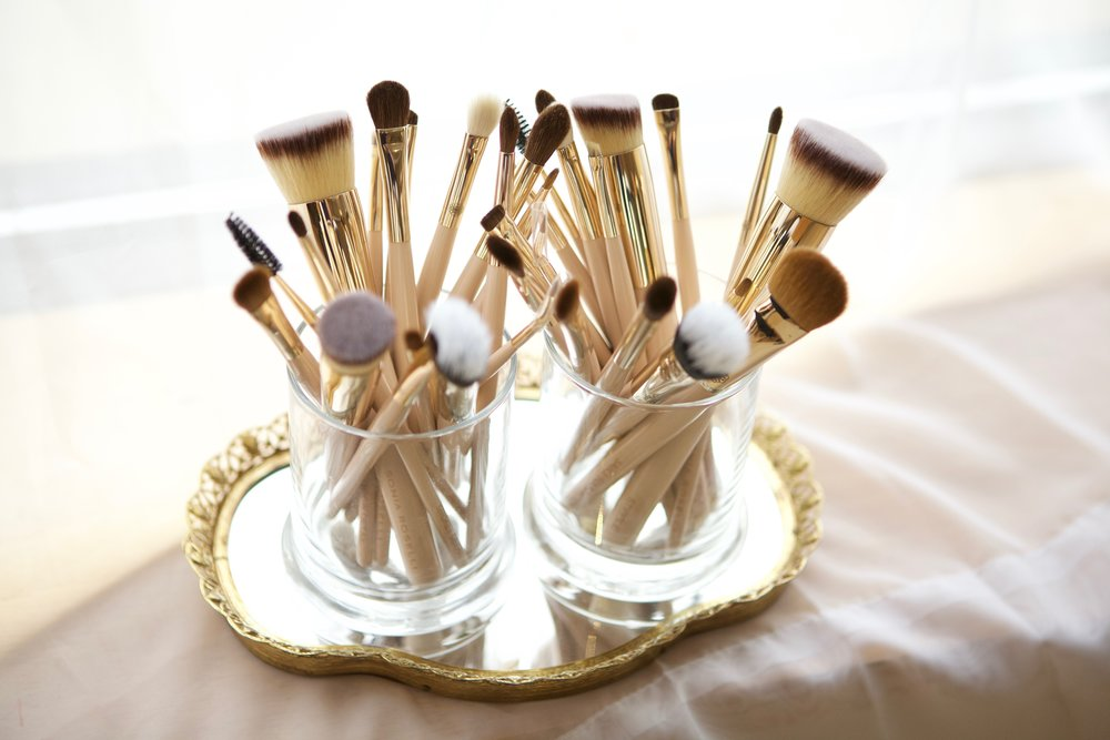 Despite rumors, you can dry brushes upright. Thanks to capillary action. But ONLY if you properly towel dry.  If you don't, dry on the side.