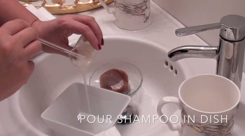 1. Pour brush shampoo into shallow dish or bowl.