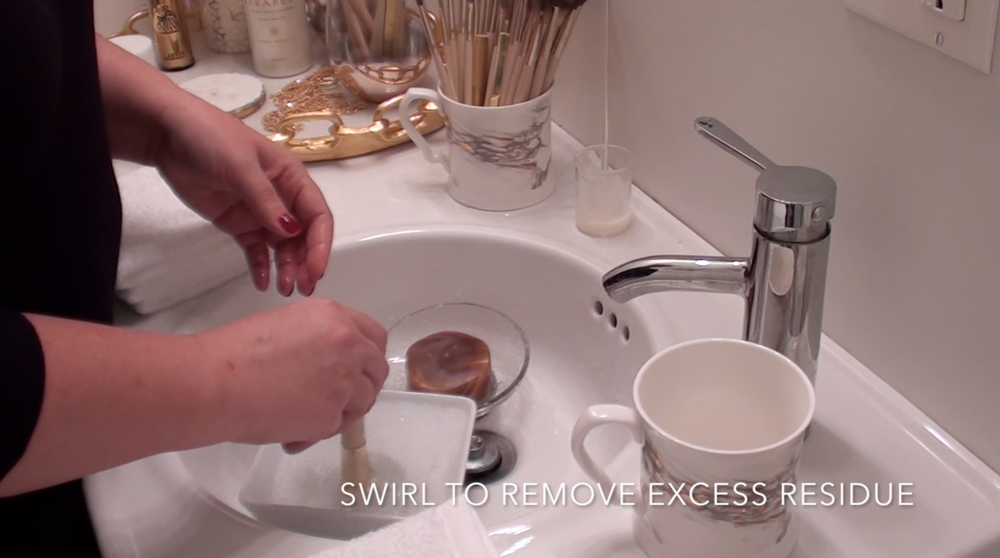6. Swirl brush in brush bath to remove excess residue from brush soap.