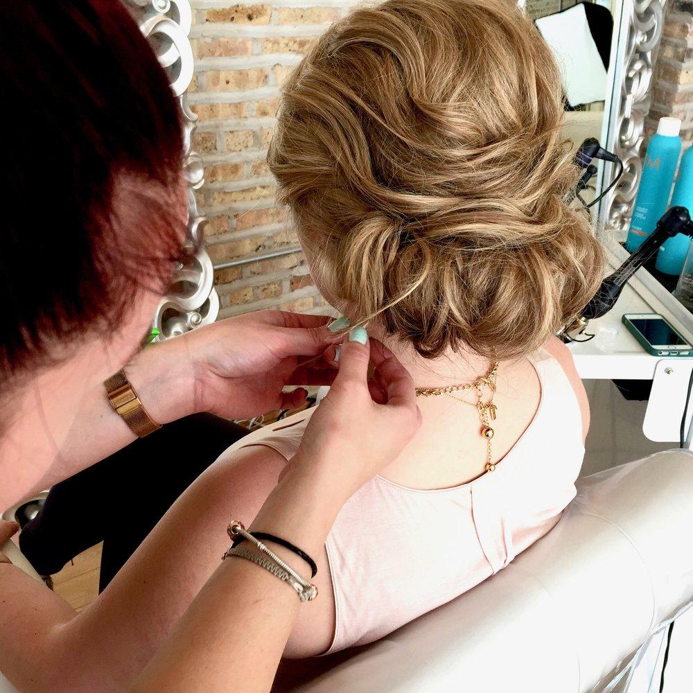 Our lovely hair girl, Sara, finishing up a wedding hair look.