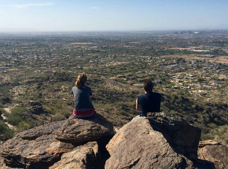Sitting on the edge of a cliff overlooking Phoenix metro area with a colleague (the rest of our group was just to the side and behind taking this pic)