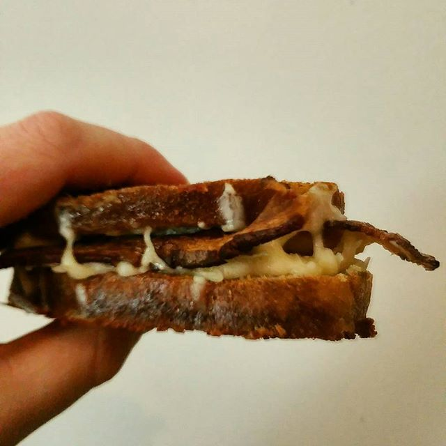 A friend gave me some homemade wheat bread, so I had to make a grilled cheese. Mozzarella, parmesan, and Benton's bacon  #grilledcheese #mozzarella #cheese #parmesan #bacon #sandwhich #dinner #foodporn #foodlove #foodstagram