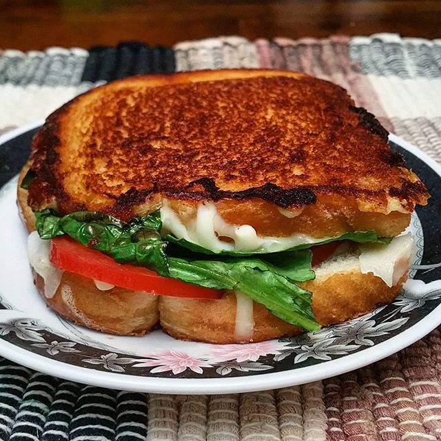 I'm back! Lettuce, tomato, mozzarella, and parmesan on white bread #GrilledCheese #cheese #cheesy #melty #foodie #foodporn #food #sandwich #foodlove #mozzarella #tomato