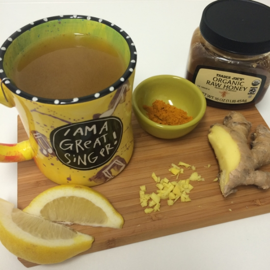 Ginger tea lemon turmeric raw honey