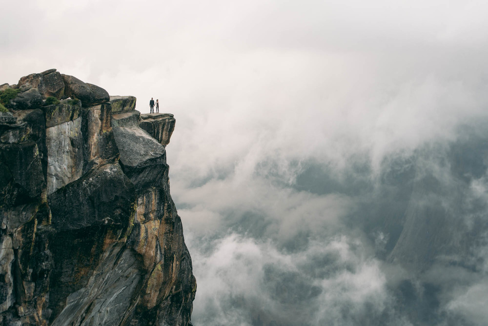 ©Isaiah & Taylor Photography - Stormy Cliffside Engagement, Yosemite California-45.jpg