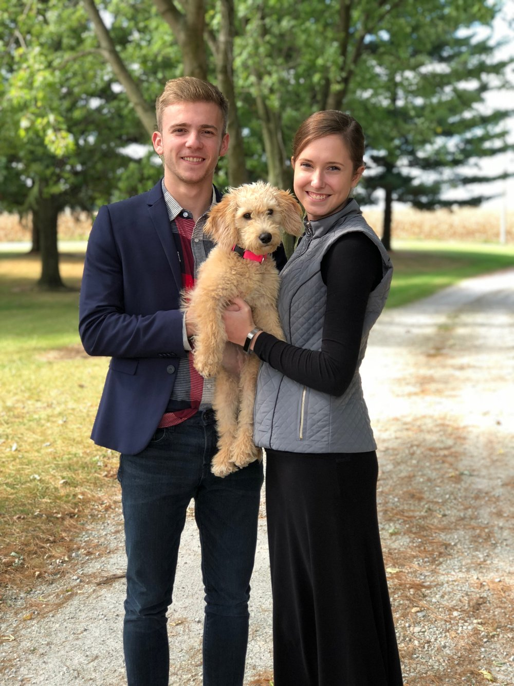 Our son Thomas and his wife with Harper their miniature F1b Goldendoodle.